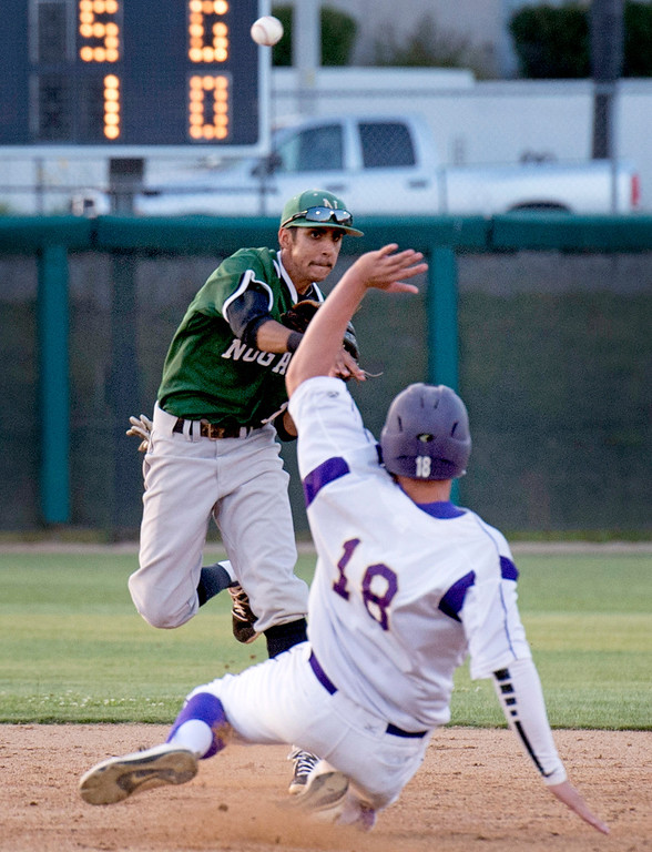 . Nogales High shortstop Adrian Guzman turns a second-inning 4-6-3 double play during the 18th annual San Gabriel Valley High School All-star Baseball game at Mt. SAC\'s Mazmanian Field June 3, 2013.   (SGVN staff photo by Leo Jarzomb)