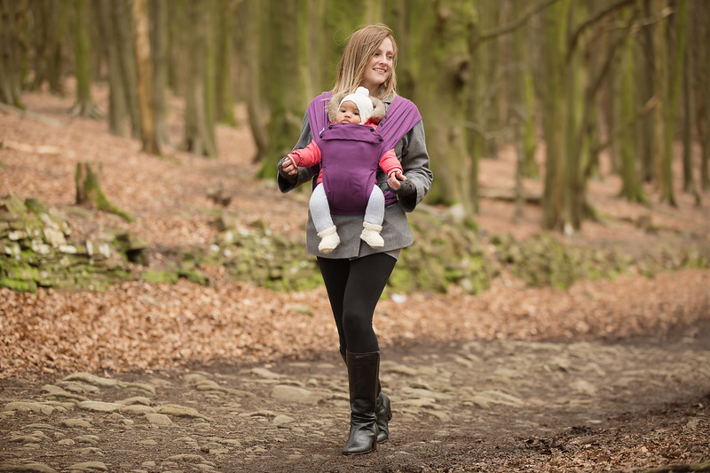 Izmi_Baby_Carrier_Cotton_Midnight_Purple_Lifestyle_Front_Carry_Holding_Baby_Hands_Landscape.jpg