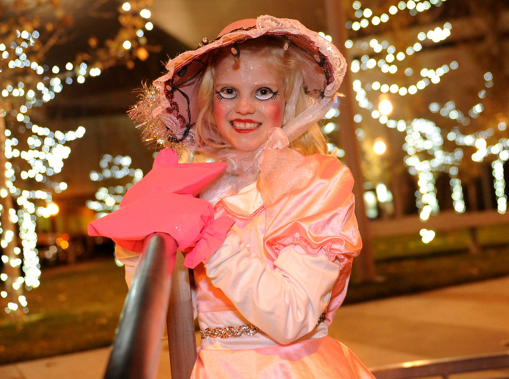 . Julia Ross, age 10, was costumed as one of Santa\'s toy dolls Friday night. The annual Parade of Lights filed past the illuminated City and County building in downtown Denver Friday night, November 30. 2012. The parade with 11 floats, 7 bands, 5 giant balloons and more lights than anyone could count, had enough holiday spirit for everyone. Karl Gehring/ The Denver Post