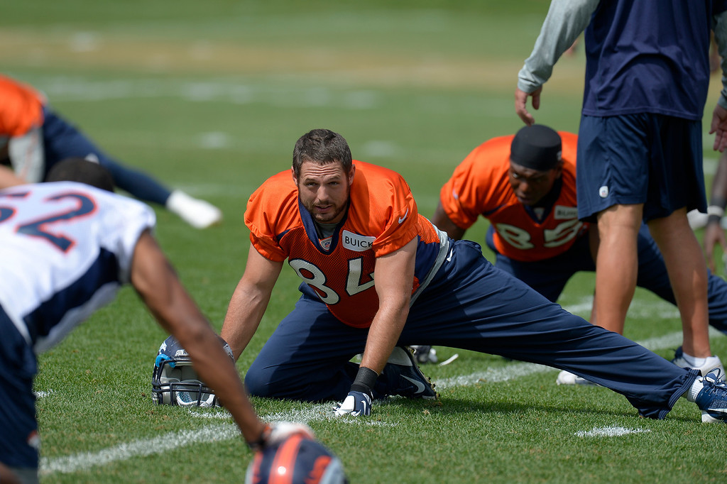 . Denver Broncos tight end Jacob Tamme (84) stretches during practice August 23, 2013 at Dove Valley (Photo by John Leyba/The Denver Post)