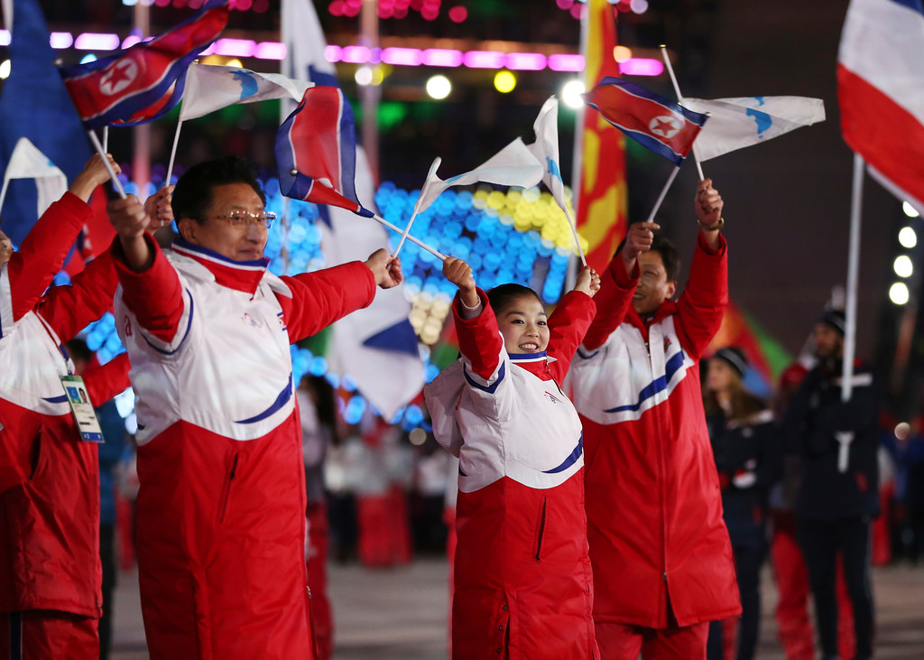 . North Koreans wave flags during the closing ceremony of the 2018 Winter Olympics in Pyeongchang, South Korea, Sunday, Feb. 25, 2018. (AP Photo/Natacha Pisarenko)