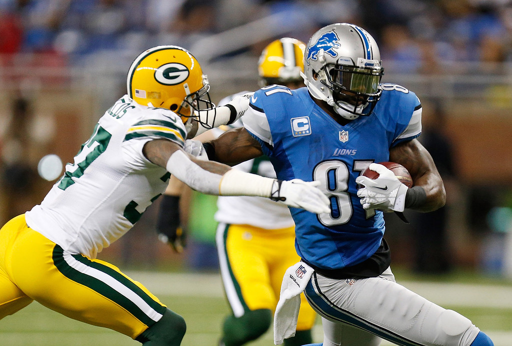 . Calvin Johnson #81 of the Detroit Lions tries to get around the tackle of Sam Shields #37 of the Green Bay Packers during the first quarter at Ford Field on November 28, 2013 in Detroit, Michigan. (Photo by Gregory Shamus/Getty Images)