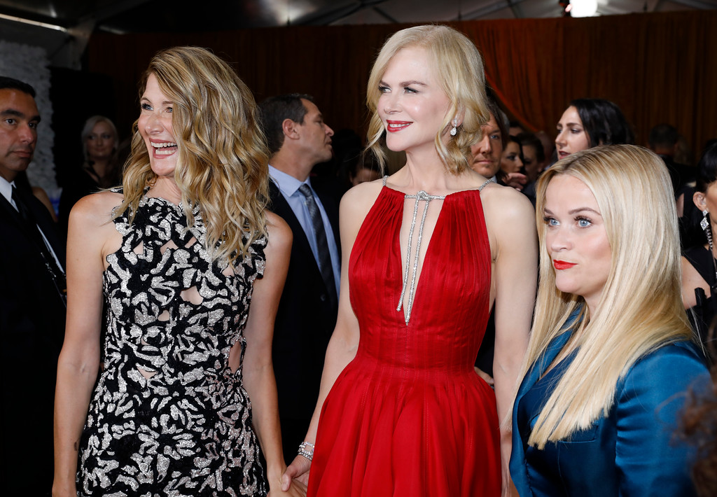 . Laura Dern, from left, Nicole Kidman, and Reese Witherspoon arrive at the 69th Primetime Emmy Awards on Sunday, Sept. 17, 2017, at the Microsoft Theater in Los Angeles. (Photo by Eric Jamison/Invision for the Television Academy/AP Images)