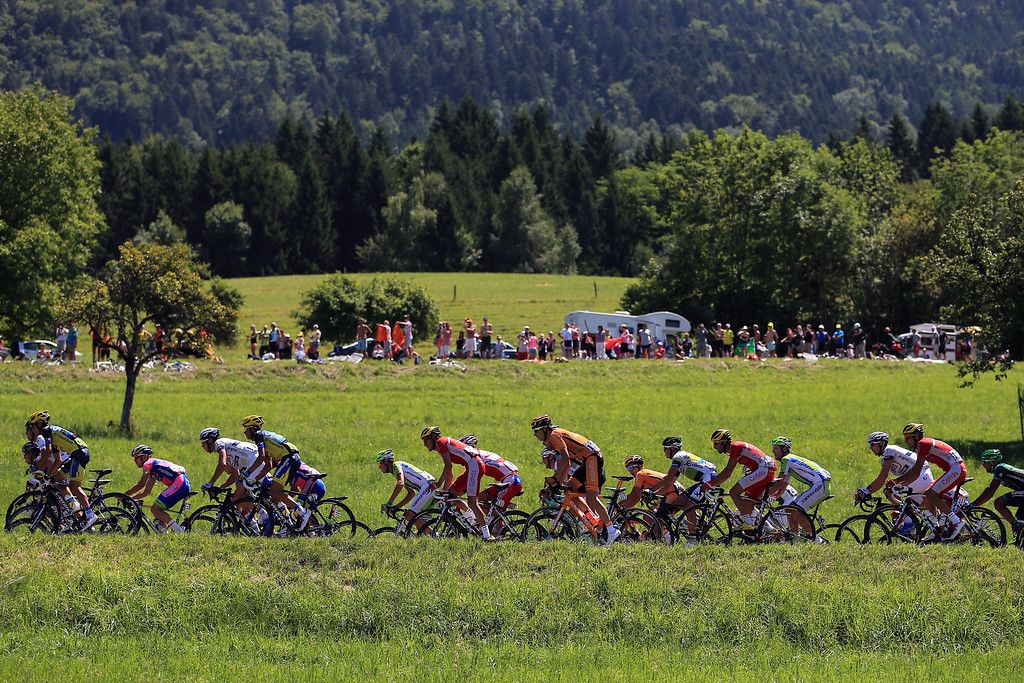 . ANNECY, FRANCE - JULY 20:  The peloton in action during stage twenty of the 2013 Tour de France, a 125KM road stage from Annecy to Annecy-Semnoz, on July 20, 2013 in Annecy, France.  (Photo by Doug Pensinger/Getty Images)