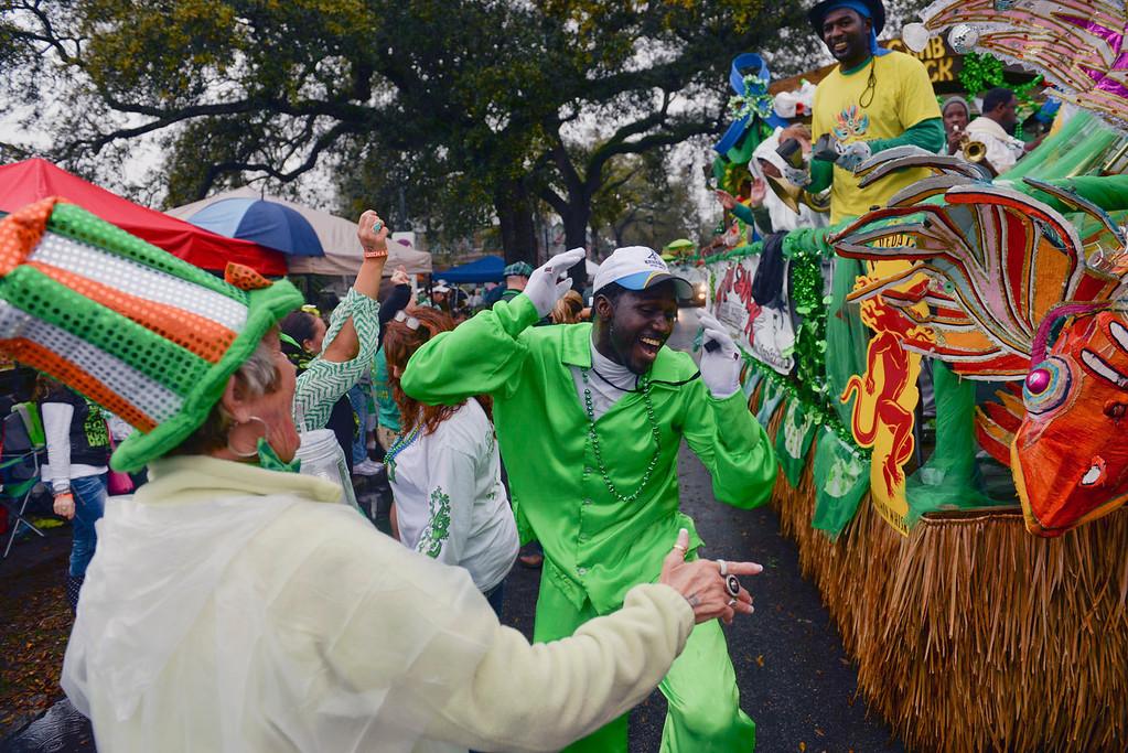 . A member of Junkanoo dances with parade goers during Savannah\'s 190-year-old St. Patrick\'s Day parade, Monday, March 17, 2014, in Savannah, Ga. (AP Photo/The Morning News, Richard Burkhart)