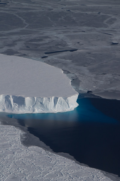 A tabular iceberg caught in sea ice in the Amundsen Sea