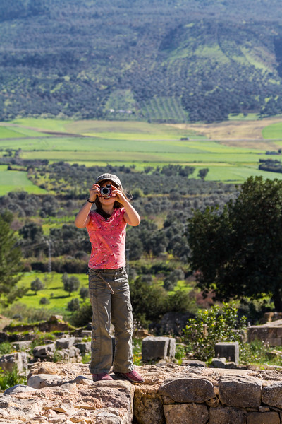Girl photographing at Ruins of Volubilis - Morocco - Volubilis