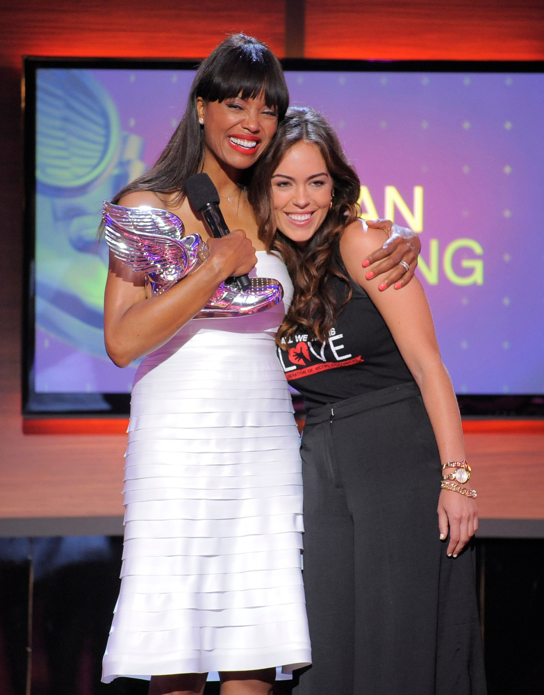 . Presenter Aisha Tyler, left, hugs nominee Jillian Mourning, of All We Want is L.O.V.E., on stage at the Do Something Awards at the Avalon on Wednesday, July 31, 2013, in Los Angeles. (Photo by Chris Pizzello/Invision/AP)