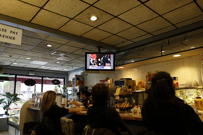 People watching history being made at athe Malibu Diner as President Obama is inaugurated.