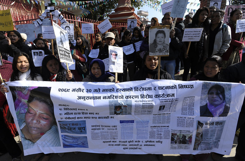 . Nepalese activists shout slogans as they march near the Prime Minister\'s residence in Kathmandu on January 3, 2013, during a protest demanding justice in rising cases of violence against women.  Hundreds of Nepalese campaigners have protested over the alleged rape and robbery of a maid by government officials, echoing widespread anger in neighbouring India over violence against women.   PRAKASH MATHEMA/AFP/Getty Images