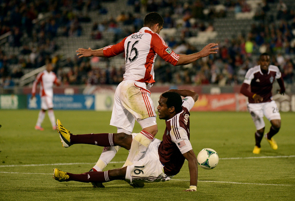 . COMMERCE CITY, CO. - MAY 04 : Colorado Rapids #16 Atiba Harris, bottom, fouled by Darel Russell #16 of Toronto FC in the 2nd half of the game at Dick\'s Sporting Goods Park in Commerce City, Colorado. May 4, 2013. Colorado won 1-0. (Photo By Hyoung Chang/The Denver Post)