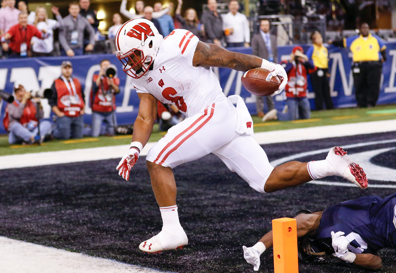 Wisconsin Badgers running back Corey Clement (6) scores a touchdown during the first half of the Wisconsin Badgers against the Penn State Nittnay Lions for the Big Ten football championship at Lucas Oil Stadium in Indianapolis, Ind., Saturday, Dec. 3, 2016. (Photo by Sam Riche)