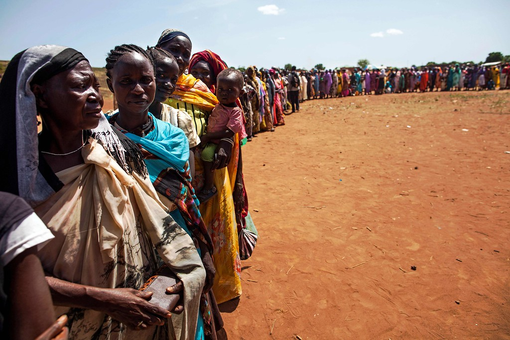 . Internally displaced people (IDPs) recently arrived to Wau, South Sudan, due to armed clashes in surrounding villages, wait to be registered by the International Organization for Migration (IOM) and the World Food Programme (WFP) on May 11, 2016.  / AFP PHOTO / ALBERT GONZALEZ FARRAN/AFP/Getty Images