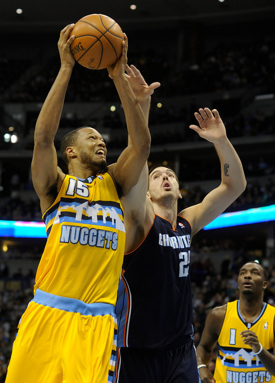 . Denver forward Anthony Randolph (15) drove the lane against Charlotte center Byron Mullens (22) in the second half. The Denver Nuggets defeated the Charlotte Bobcats 110-88 at the Pepsi Center Saturday night, December 22, 2012.  Karl Gehring/The Denver Post