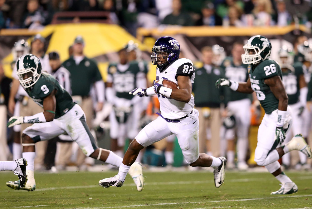 . Wide receiver Josh Boyce #82 of the TCU Horned Frogs runs with the football on a 61 yard reception during the Buffalo Wild Wings Bowl against the Michigan State Spartans at Sun Devil Stadium on December 29, 2012 in Tempe, Arizona.  (Photo by Christian Petersen/Getty Images)