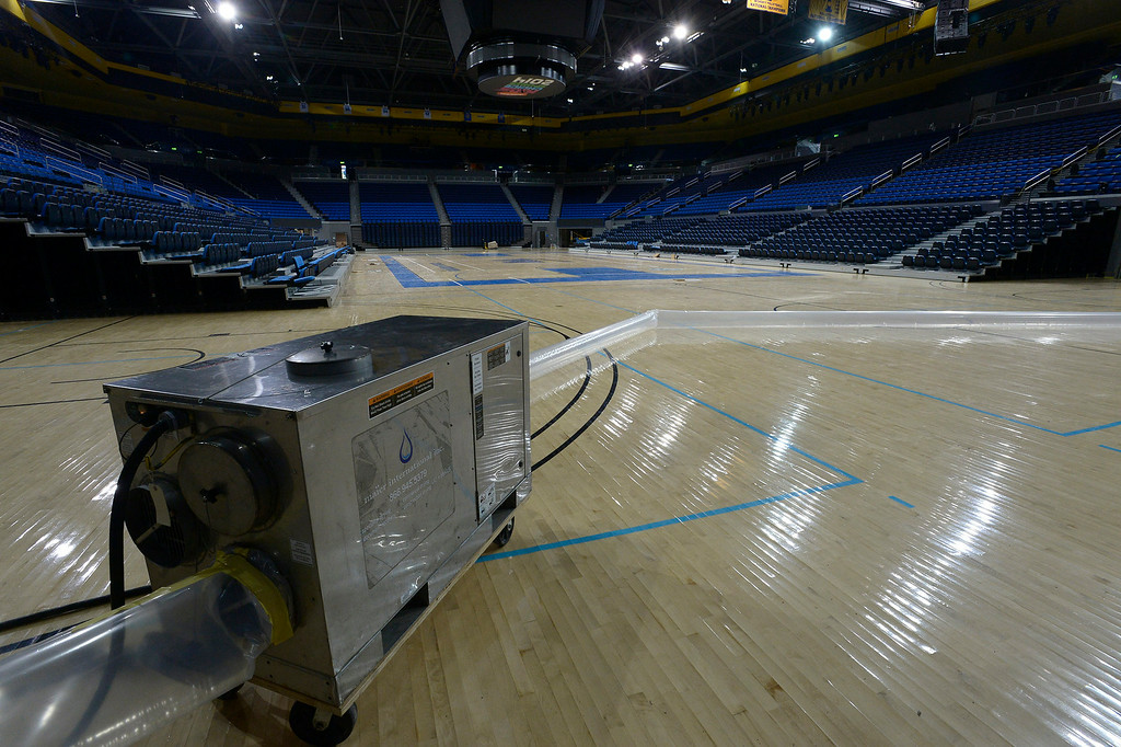 . The wood floors inside Pauley Pavilion are being dried out with special ventilation equipment. The newly renovated athletic center was flooded when water rushed in from a pipeline that burst open on Sunset Blvd. Westwood, CA. 7/31/2014(Photo by John McCoy Daily News)