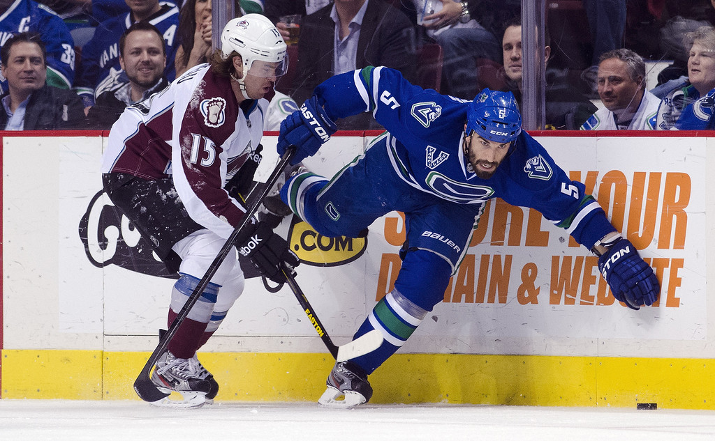 . Aaron Volpati #15 of the Vancouver Canucks is upended by PA Parenteau #15 of the Colorado Avalanche during the first period in NHL action on March 28, 2013 at Rogers Arena in Vancouver, British Columbia, Canada.  (Photo by Rich Lam/Getty Images)