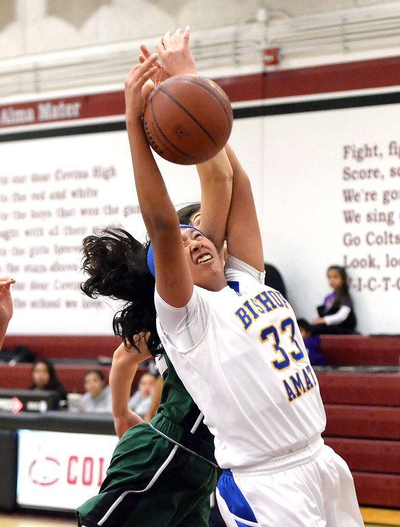 . Bishop Amat\'s Jurhandi Molina (33) rebounds against Bonita in the first half of the Covina basketball tournament at Covina High School in Covina, Calif., on Saturday, Dec. 14, 2013. Bonita won 49-41.   (Keith Birmingham Pasadena Star-News)