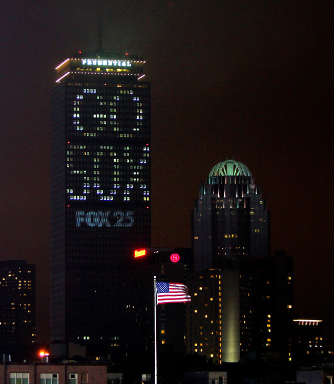 """. The Prudential Building in downtown Boston is lit up with \""""Go Sox\"""" on Sunday, Oct. 24, 2004, before the start of Game 2 of the World Series against the Boston Red Sox and the St. Louis Cardinals.  (AP Photo/Chitose Suzuki)"""