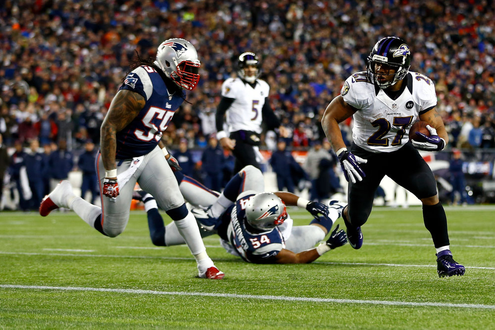 Description of . Ray Rice #27 of the Baltimore Ravens runs the ball to score a touchdown in the second quarter against Brandon Spikes #55 of the New England Patriots during the 2013 AFC Championship game at Gillette Stadium on January 20, 2013 in Foxboro, Massachusetts.  (Photo by Jared Wickerham/Getty Images)
