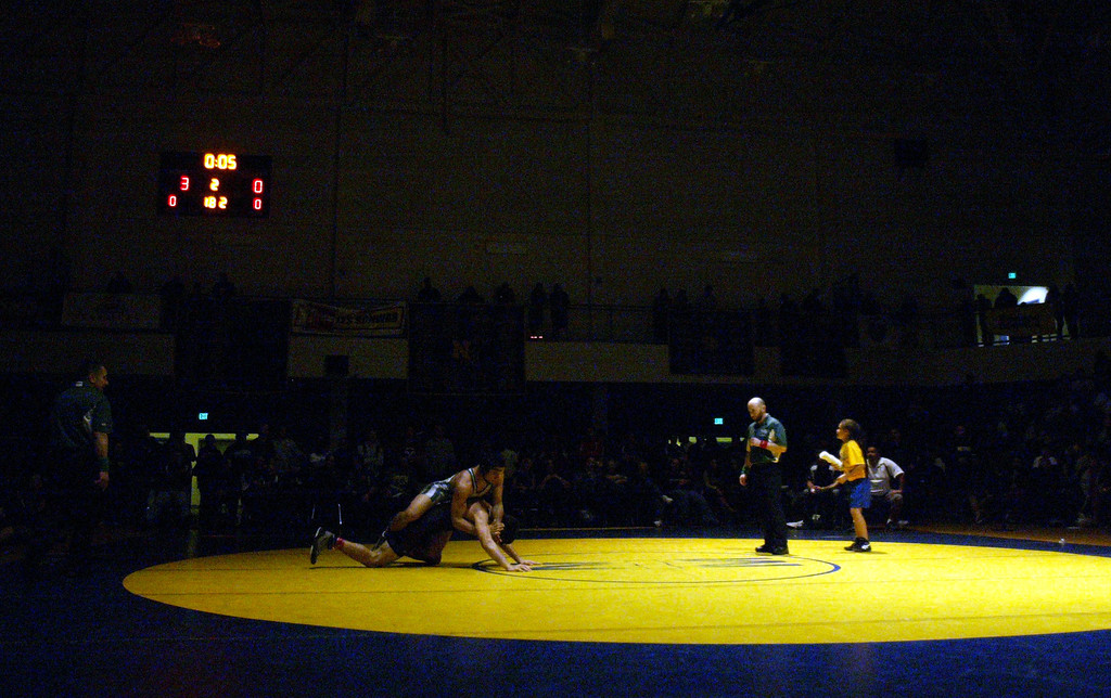 . De La Salle\'s Devin Aiello, top, wrestles Fort Bragg\'s Jacob Clark in the 182-pound finals at the North Coast Section wrestling championships held at Newark Memorial High School in Newark, Calif., on Saturday, Feb. 23, 2013. Aiello would get the win. (Anda Chu/Staff)