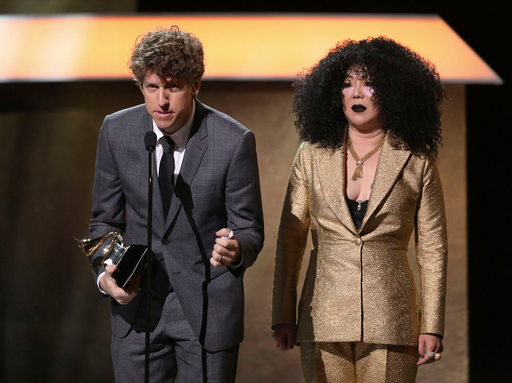 . Greg Kurstin, left, accepts the award for producer of the year, non-classical as Margaret Cho looks on at the 59th annual Grammy Awards on Sunday, Feb. 12, 2017, in Los Angeles. Looking on from right is presenter Margaret Cho.(Photo by Matt Sayles/Invision/AP)