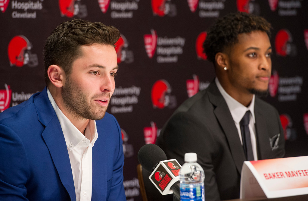 . Cleveland Browns first-round draftee Baker Mayfield, left, answers a question as Denzel Ward listens during a news conference at the team\'s headquarters in Berea, Ohio, Friday, April 27, 2018. (AP Photo/Phil Long)