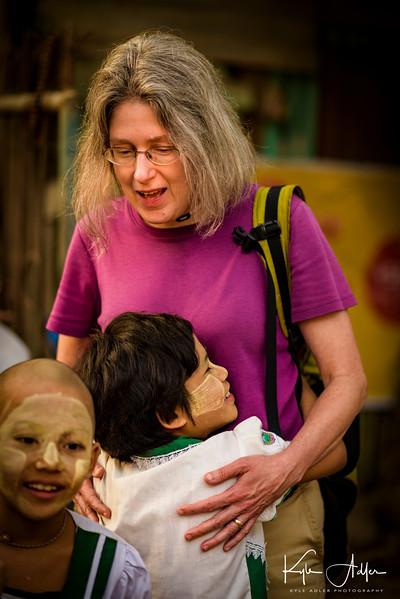 Mary hugs her new friend goodbye as we prepare to depart the Aye Yeik Mon Girls' Orphanage.