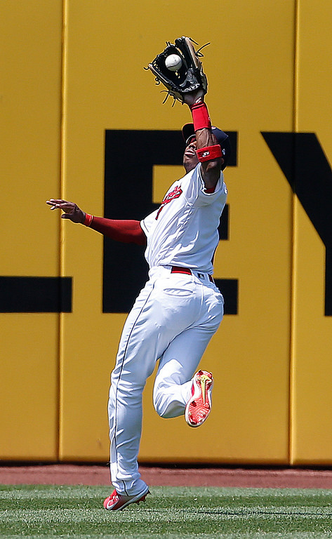 . Cleveland Indians\' Greg Allen makes a catch to get out New York Yankees\' Didi Gregorius during the fifth inning of a baseball game, Sunday, July 15, 2018, in Cleveland. (AP Photo/Ron Schwane)