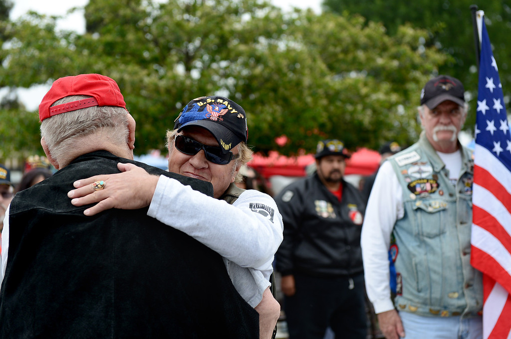 . After walking past the Patriot Guard Riders, Vietnam Veteran Leon Burns, left, gets a hug from a Patriot Guard before receiving the Navy Cross during Jose Ramos\' annual Welcome Home Vietnam Veterans Day at California High School in Whittier Saturday, April 13, 2013.  (SGVN/Staff Photo by Sarah Reingewirtz)