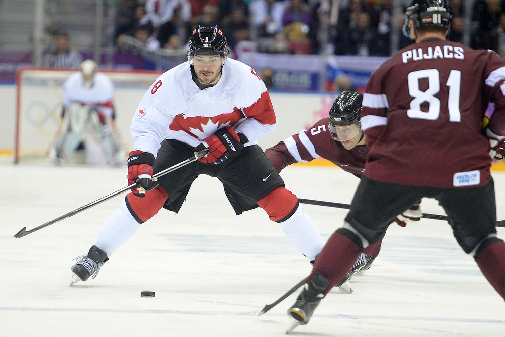 . Drew Doughty (8) of the Canada controls the puck against Latvia during the third period of Canada\'s 2-1 win over Latvia. Sochi 2014 Winter Olympics on Wednesday, February 19, 2014 at Bolshoy Ice Arena. (Photo by AAron Ontiveroz/ The Denver Post)