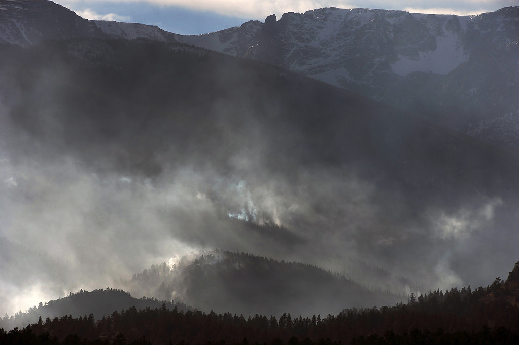. Despite snow higher up on the north slopes The Fern Lake Fire burns in Rocky Mountain National Park on December 2, 2012.