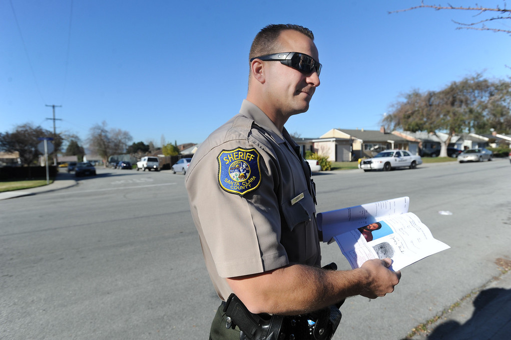 . Santa Clara County Sheriff\'s Deputy Ryan Griep looks at a printout after attempting to make contact with a man, who it turns out was deceased, at a home in an unincorporated portion of East San Jose, Calif. on Monday, Feb. 11, 2013. The Santa Clara County Sheriff\'s Office is increasing its efforts to take once lawfully owned firearms from those who can no longer own them due to more recent circumstances in their lives. Officers are attempting to make contact with these people to ask them to voluntarily turn over any firearms. A monthly list of these people is put out by the Department of Justice. (Dan Honda/Staff)
