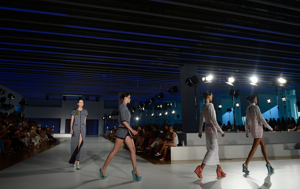 . Models wear creations from Naulover during a 080 Barcelona fashion show in Barcelona, Spain, Friday, July 12, 2013.  (AP Photo/Manu Fernandez)