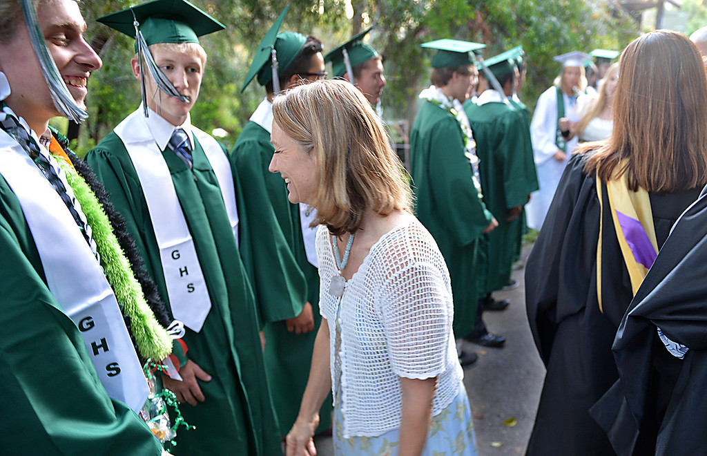 . Gena Engelfried, Grove School founder and head of school, shares a moment with students before graduation ceremonies. The Grove School in Redlands graduates the Class of 2014 Thursday June 12, 2014  in the Avice Meeker Sewall Theater in Prospect Park, Redlands. This is Engelfried\'s final graduation ceremony with the school, she is moving to Sumatra where she\'ll act as a consultant to schools looking to establish secondary-level Montessori education. (Photo by Rick Sforza/Redlands Daily Facts)