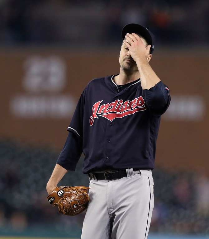 . Cleveland Indians relief pitcher Andrew Miller wipes his face after giving up a bases loaded walk during the seventh inning of a baseball game against the Detroit Tigers, Tuesday, May 15, 2018, in Detroit. (AP Photo/Carlos Osorio)