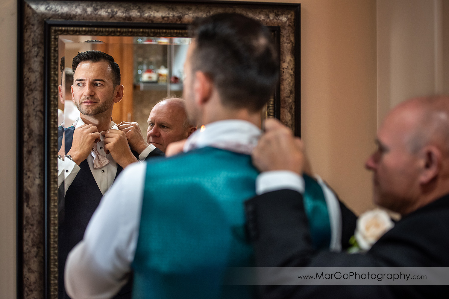 groom getting ready in front of mirror in Walnut Creek