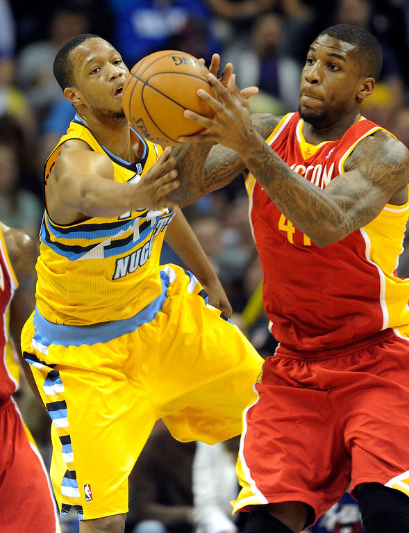 . DENVER, CO. - APRIL 6: Anthony Randolph (15) of the Denver Nuggets hustled for a loose ball with Thomas Robinson (41) of the Houston Rockets in the second half. The Denver Nuggets defeated the Houston Rockets 132-114 at the Pepsi Center Saturday night, April 6, 2013. Photo By Karl Gehring/The Denver Post)
