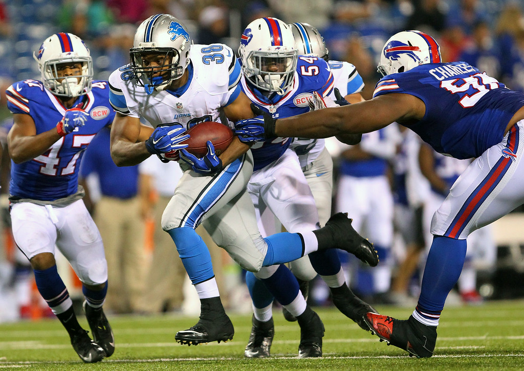 . Detroit Lions running back George Winn (38) runs with the ball against the Buffalo Bills during the second half of a preseason NFL football game, Thursday, Aug. 28, 2014, in Orchard Park, N.Y. (AP Photo/Bill Wippert)