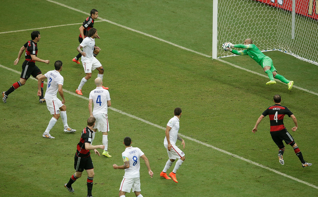 . United States\' goalkeeper Tim Howard blocks a shot by during the group G World Cup soccer match between the USA and Germany at the Arena Pernambuco in Recife, Brazil, Thursday, June 26, 2014. (AP Photo/Hassan Ammar)