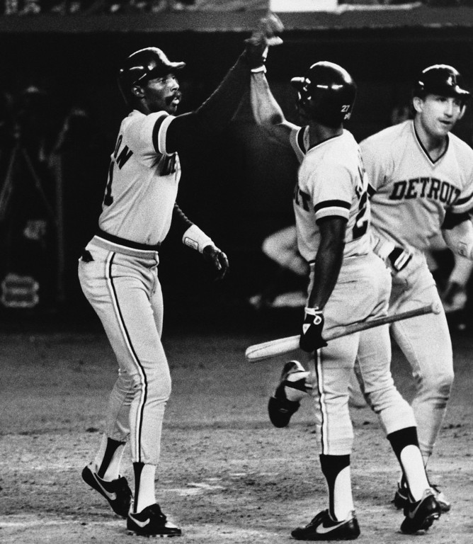 . Detroit Tigers designated hitter Barbaro Garbey (center) congratulates Larry Herndon (left) after Herndon�s fifth-inning two-run homer put the Tigers into a 3-2 lead over the San Diego Padres in the first game of the World Series at night, Tuesday, Oct. 10, 1984 in San Diego. Lance Parrish who was knocked in by Herndon heads for the dugout. The Tigers kept the lead to win the first game of the series, 3-2. (AP Photo)