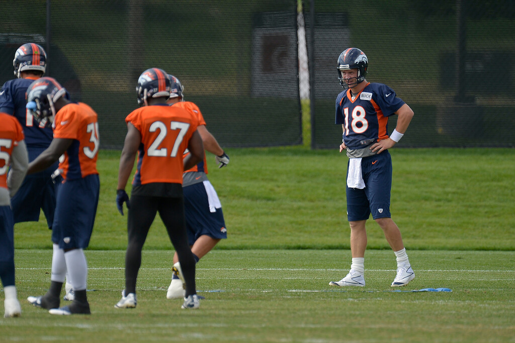 . Denver Broncos quarterback Peyton Manning (18) watches the running backs during practice August 23, 2013 at Dove Valley (Photo by John Leyba/The Denver Post)