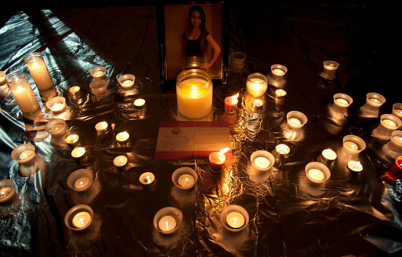 """. In this Friday, Oct. 19, 2012, file photo, candles are displayed in front of a picture of Amanda Todd during a memorial for her in Surrey, British Columbia. In Google\'s 12th annual roundup of global trending searches, \""""Amanda Todd\"""" was ranked eighth. Amanda Todd ranked as Google\'s third most searched trending person of 2012. (AP Photo/The Canadian Press, Jonathan Hayward)"""