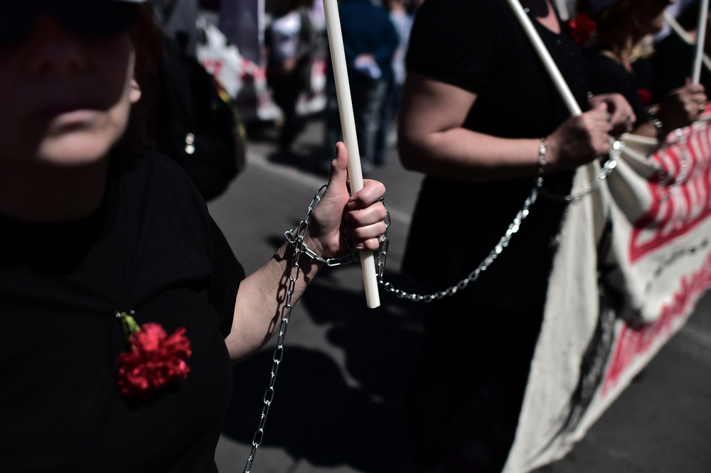 . Greek protesters chained to each other take part in a demonstration marking May Day in Athens on May 1, 2014. (ARIS MESSINIS/AFP/Getty Images)