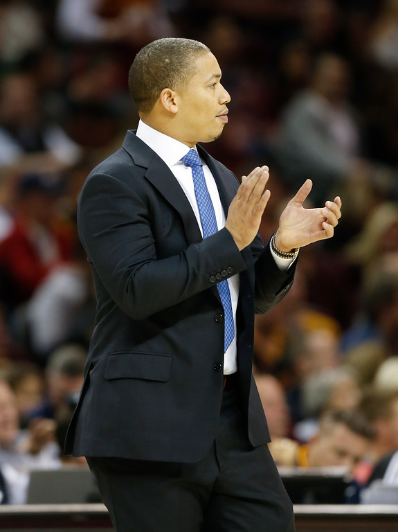 . Cleveland Cavaliers head coach Tyronn Lue applauds his team during the first half of an NBA basketball game against the Detroit Pistons Friday, Nov. 18, 2016, in Cleveland. The Cavaliers won 104-81. (AP Photo/Ron Schwane)