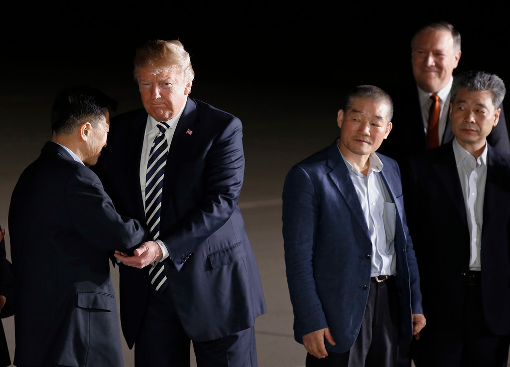 . President Donald Trump, accompanied by Secretary of State Mike Pompeo, back right, shakes hands with former North Korean detainees Tony Kim, arriving with Kim Dong Chul, and Kim Hak Song, right, at Andrews Air Force Base, Md., Thursday, May 10, 2018. (AP Photo/Alex Brandon)