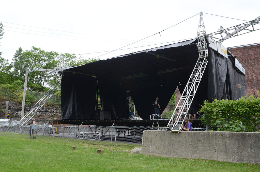 . Gillian Jones/North Adams Transcript Workers put together the outdoor stage at Joe\'s Field  for Solid Sound this weekend at Mass MoCA.