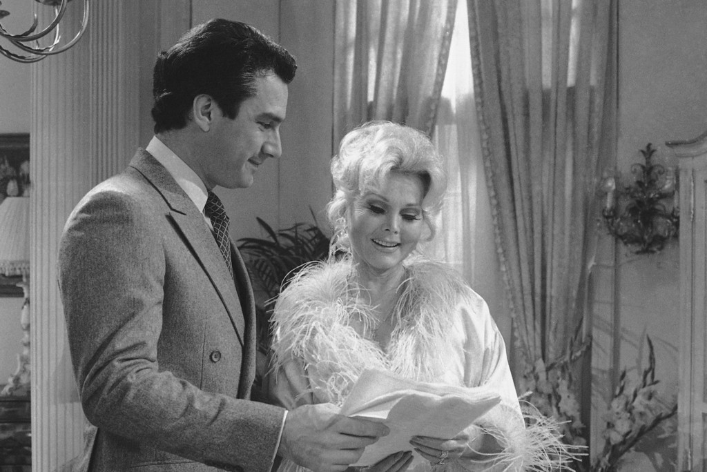". Zsa Zsa Gabor goes through her lines with Anthony Herrera in New York on Thursday, Nov. 20, 1981 as they prepared to shoot a segment for the soap opera ""As the World Turns.\""     She will be in the series from Nov. 20 to Dec. 7, 1981.     (AP Photo/Marty Lederhandler)"