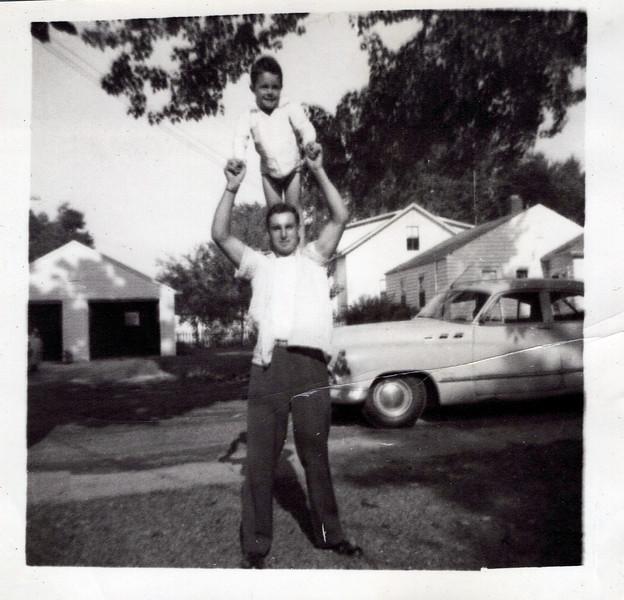1950s Lloyd Konyha with butch on his shoulders.jpeg