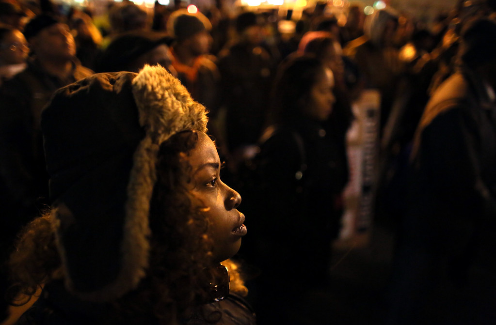 . People gather in front of the Adam Clayton Powell Jr. State office building during a protest December 4, 2014 in New York City. Protests began after a Grand Jury decided to not indict officer Daniel Pantaleo. Eric Garner died after being put in a chokehold by Pantaleo on July 17, 2014. Pantaleo had suspected Garner of selling untaxed cigarettes. (Photo by Yana Paskova/Getty Images)